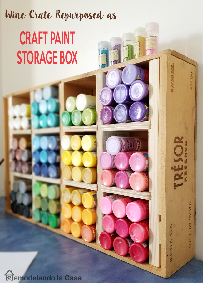craft room organization - red, pink, purple, blue, black and white paint storage