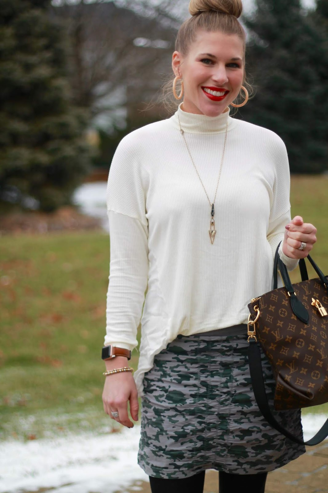 XCVI review, camo skirt, white turtleneck tunic, LV flowered tote, grey booties, JORD apple watch strap