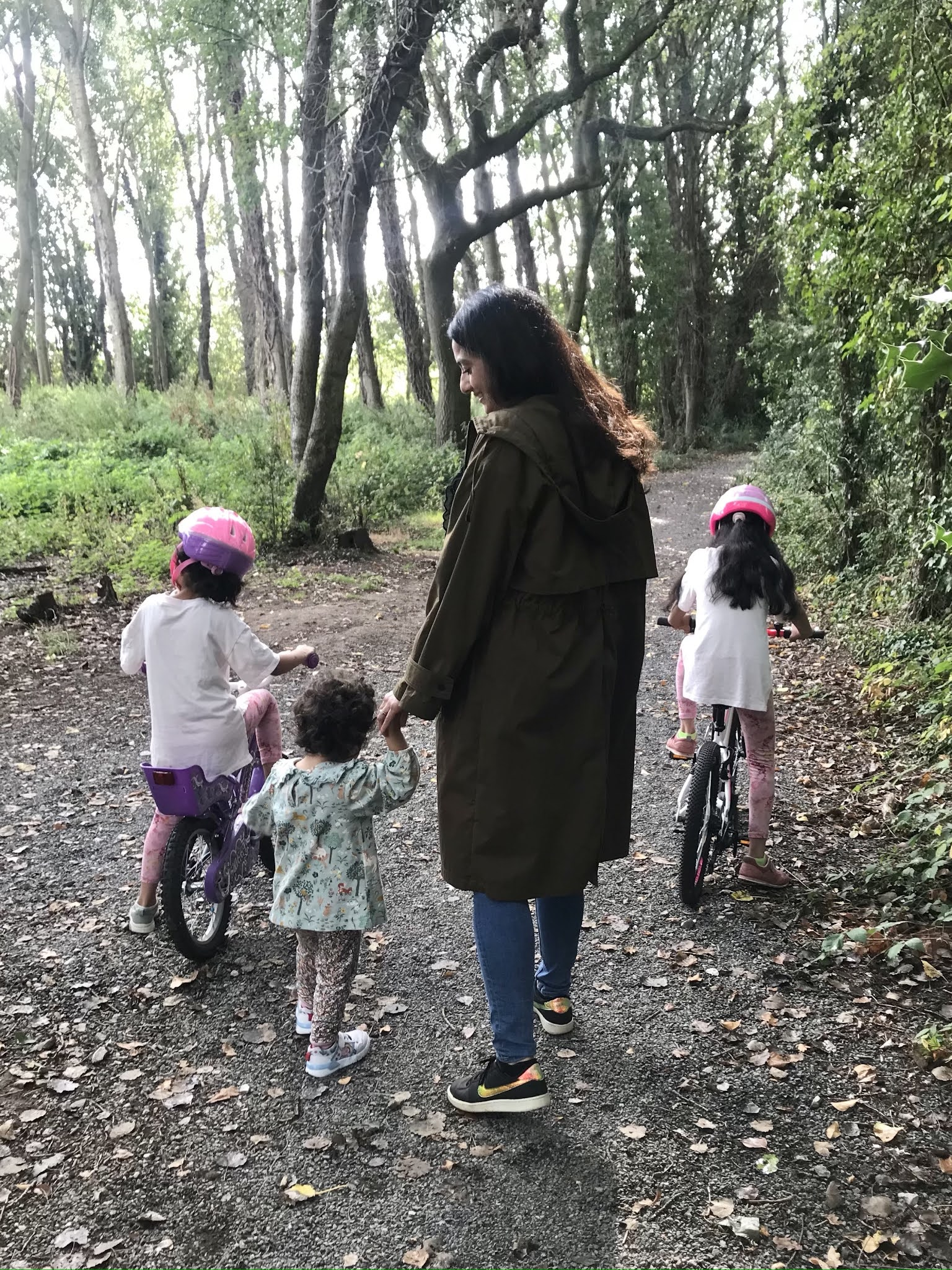 amina walking with her toddler in the woods