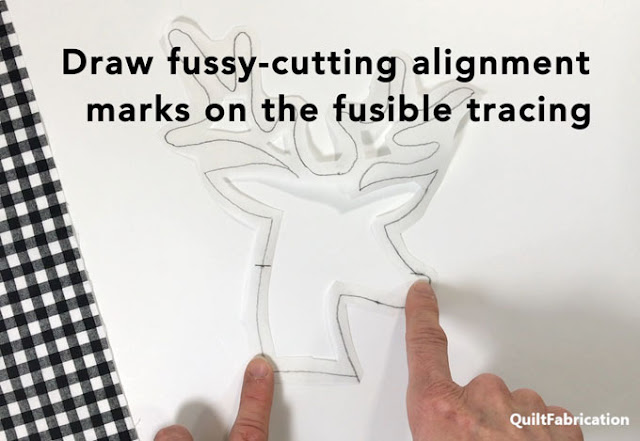 fussy cutting alignment marks made on fusible web deer head drawing  by QuiltFabrication