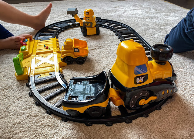 The train from the Cat Construction Junior Crew Power Tracks going round the track