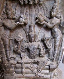Vishnu being showered by dual Kalashas (pillar  relief, Ramaswamy Temple, Kumbhakonam,  Tamil Nadu