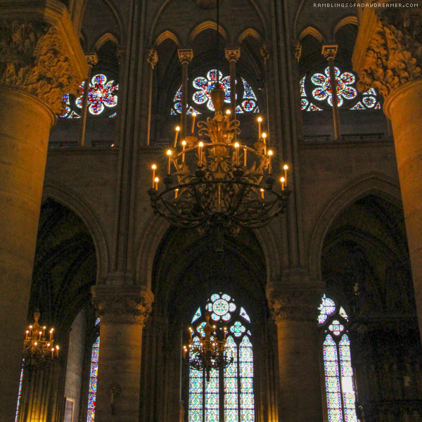 Notre Dame Cathedral Paris France interior chandeliers and stained glass windows