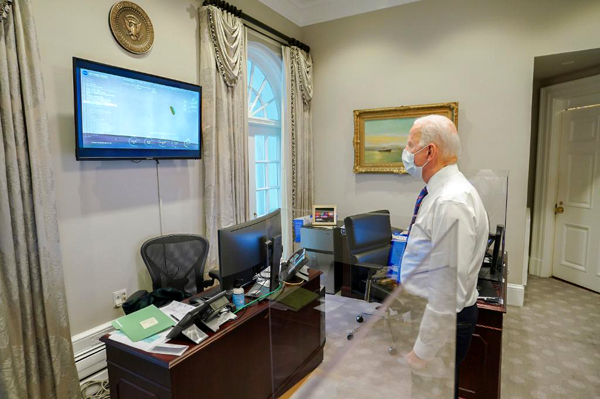 At the White House, President Joe Biden watches NASA TV coverage of the Perseverance rover's arrival at Mars' Jezero Crater...on February 18, 2021.