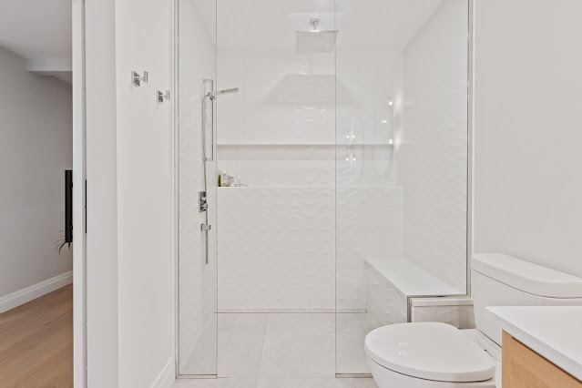 White bathroom with a zero entry shower for ultimate accessibility.