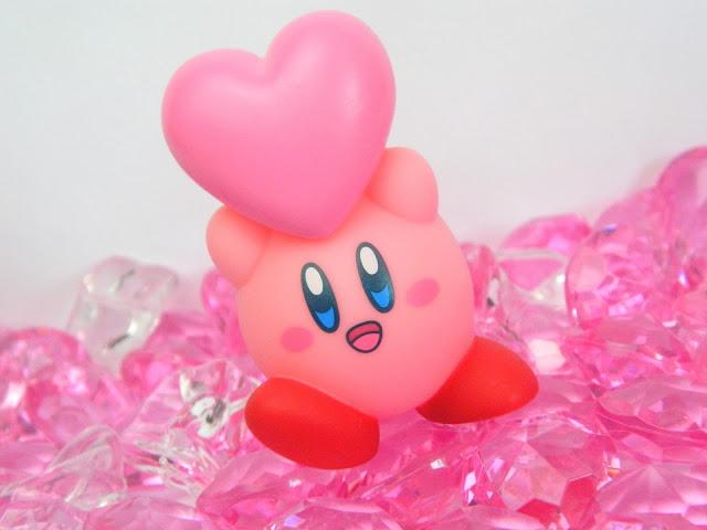 A Nintendo Kirby figure holding a pink heart