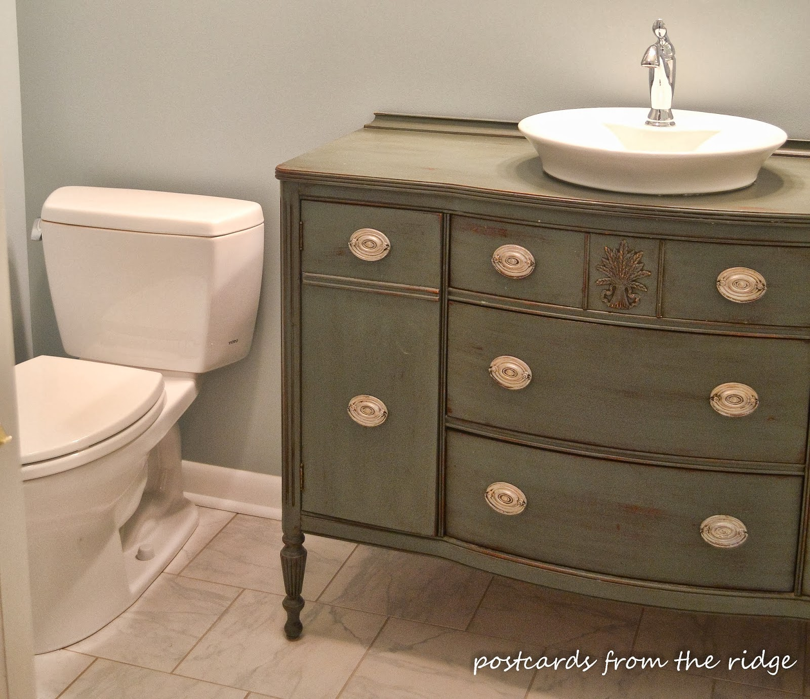 New master bath vanity created from an old dining room buffet. ~ Postcards from the Ridge