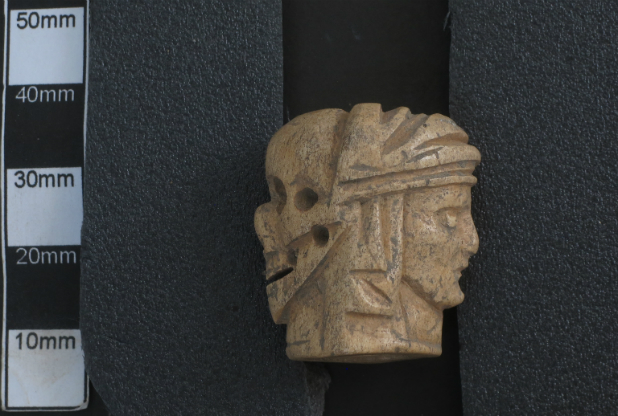 500-year-old Janus bead found under Gloucester Cathedral
