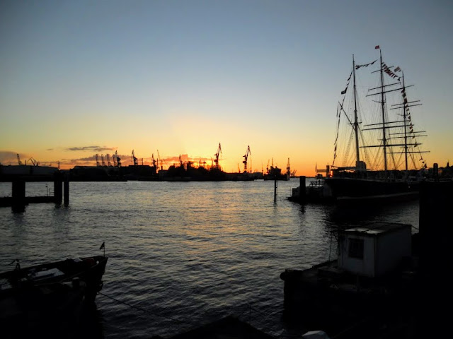 What is Hamburg famous for? Sunsets over Hamburg port.