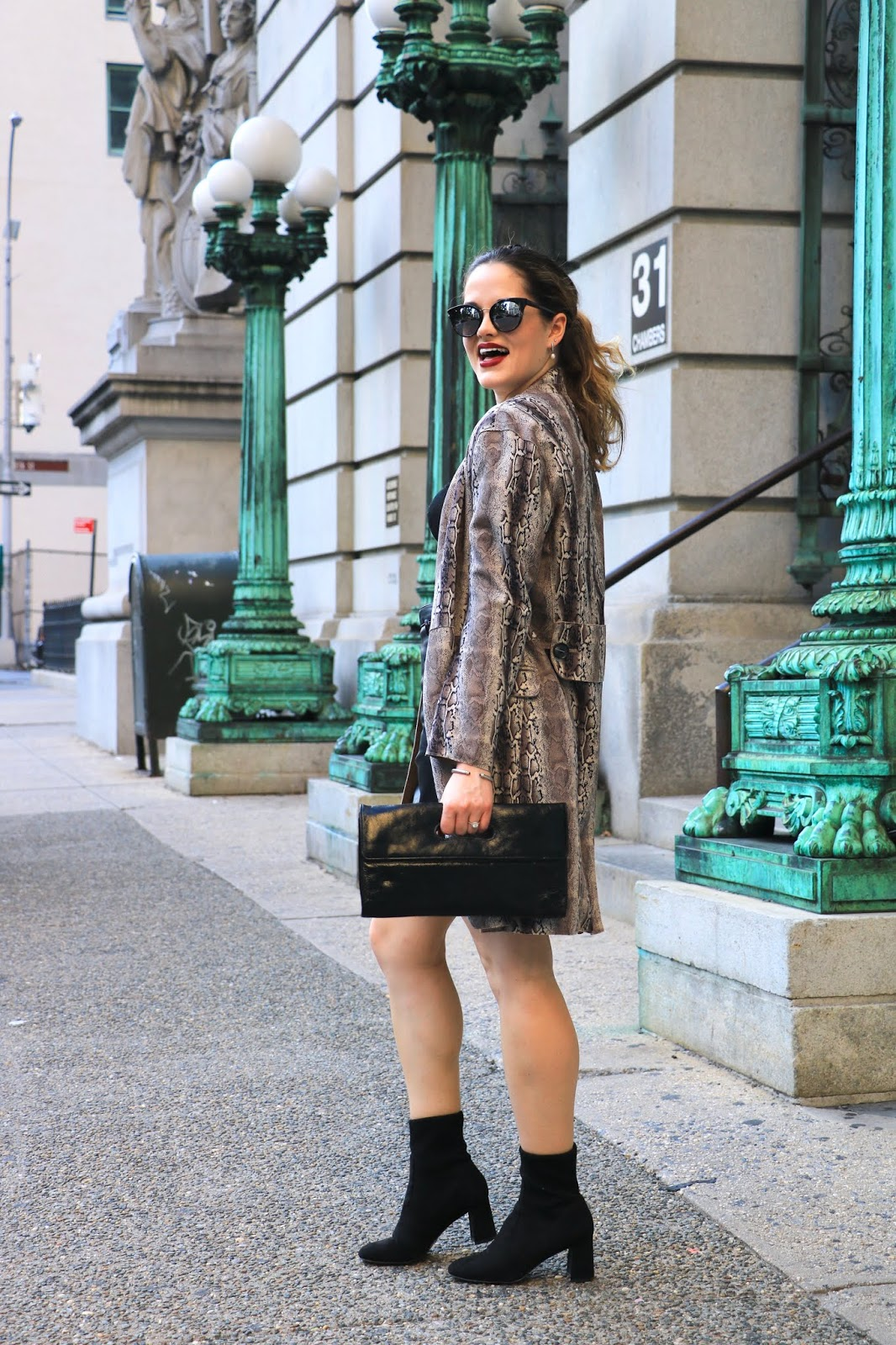 Nyc fashion blogger Kathleen Harper wearing a python print jacket.
