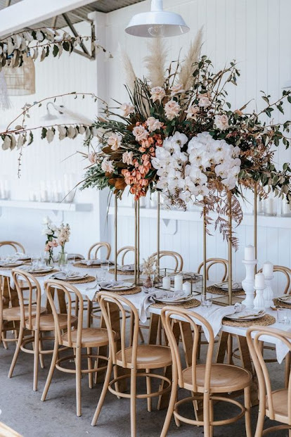 wedding ideas- wedding planning services - wedding ideas blog by K'Mich in Philadelphia PA - wedding decor - table with tall metal stand with blooms