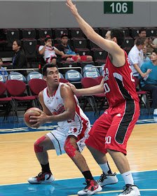 Vic Manuel fakes and pumps against Greg Slaughter