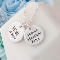 close up of silver necklace with two personalised engraved discs