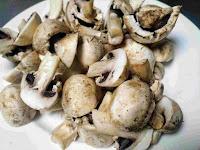 Button mushroom cut into halves for chilli mushroom recipe