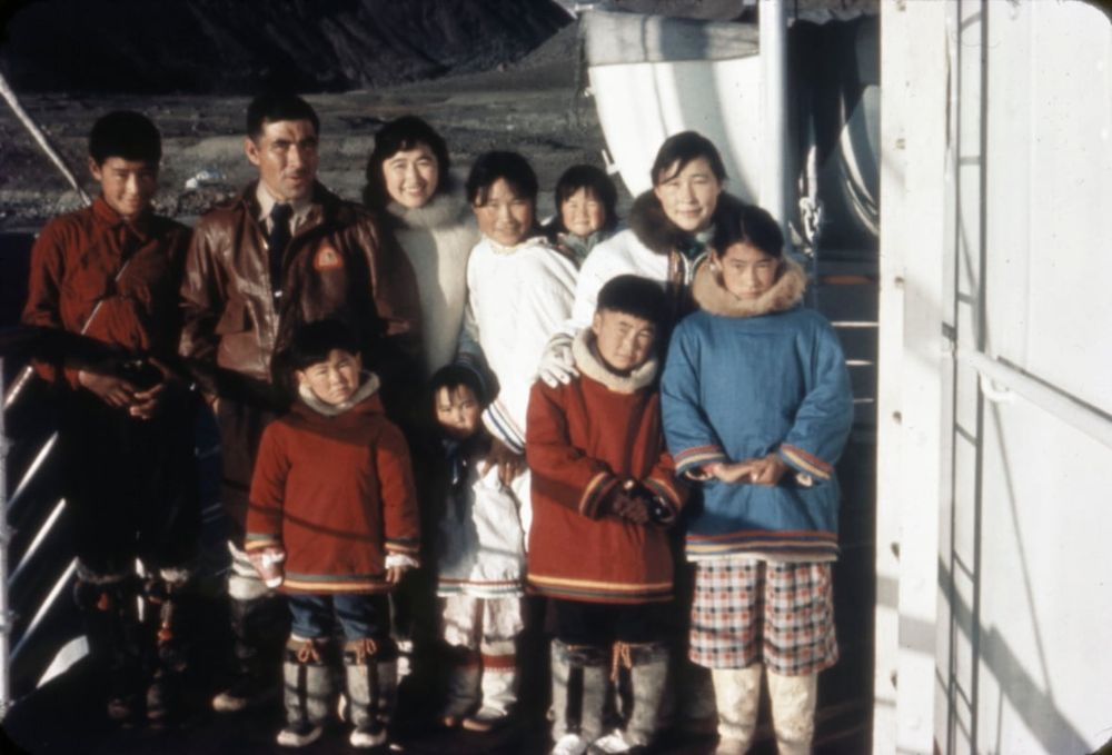 A family from Pond Inlet on board the C.D. HOWE at Grise Fiord