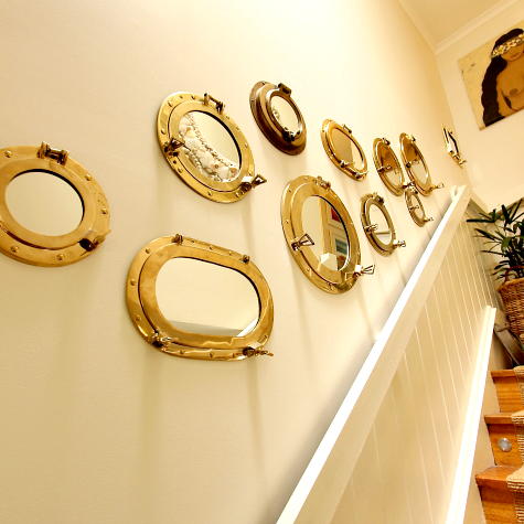 porthole mirror gallery wall staircase