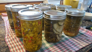jars of zucchini relish and cucumber pickles