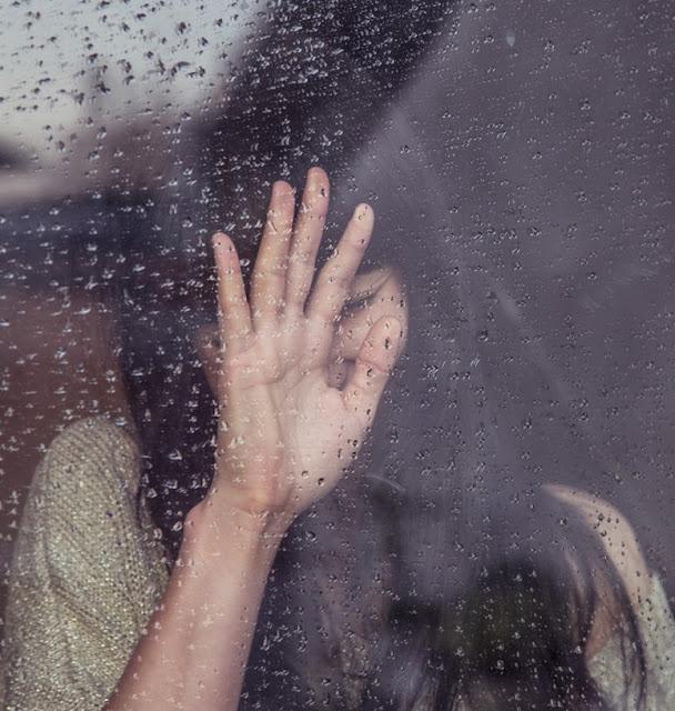 woman against a window raining  - unsplash.com