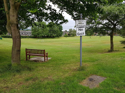 NO GOLF sign on The Green in Hawk Green, Marple, Stockport