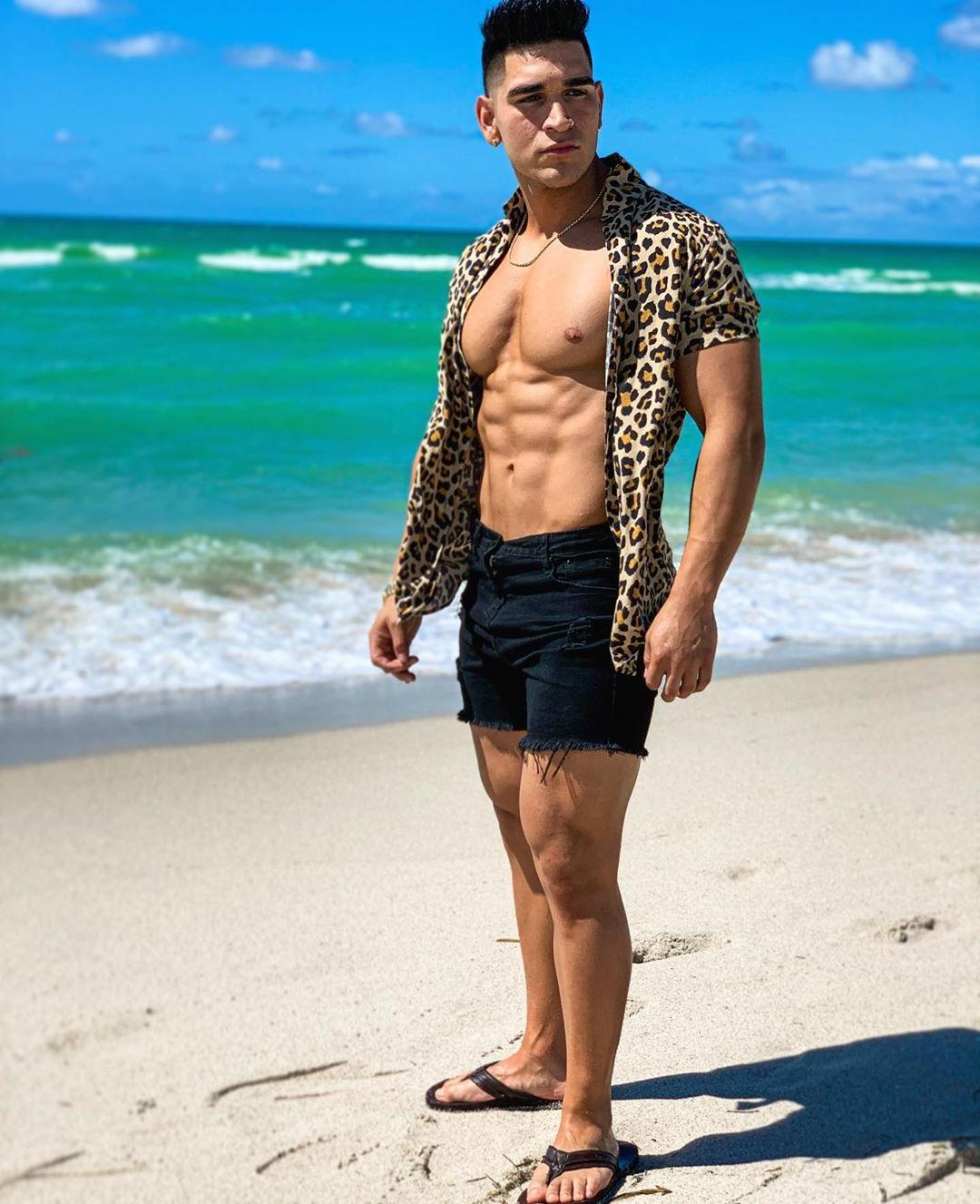 sexy-beefy-muscle-stud-huge-pecs-abs-beach