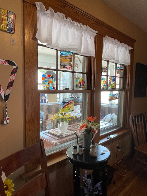 front double windows of Grafton Illinois coffee antiques shop Lightkeepers Coffee 101 E Main St Sears Vallonia