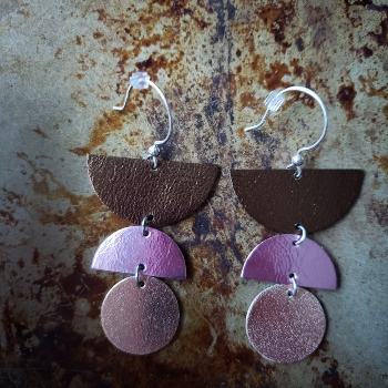 Geometric leather and sterling silver dangling earrings in metallic colors