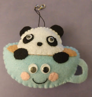 Completed ornament front (blue teacup with panda)