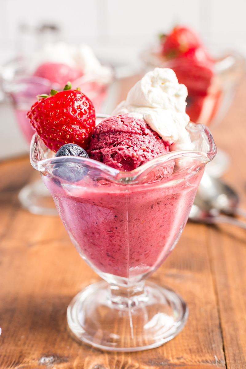 This 4 ingredient, no-churn, sugar-free mixed berry frozen yogurt recipe is keto-friendly, easy to make, and tastes delicious! #keto #lowcarb #sugarfree #nochurn #icecream #frozenyogurt #froyo #berry #dessert #easy #recipe | bobbiskozykitchen.com
