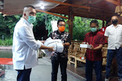 Paslon Maurits Mantiri dan Hengky Honandar Terima Bantuan APD Dari DPW Partai Perindo Sulut