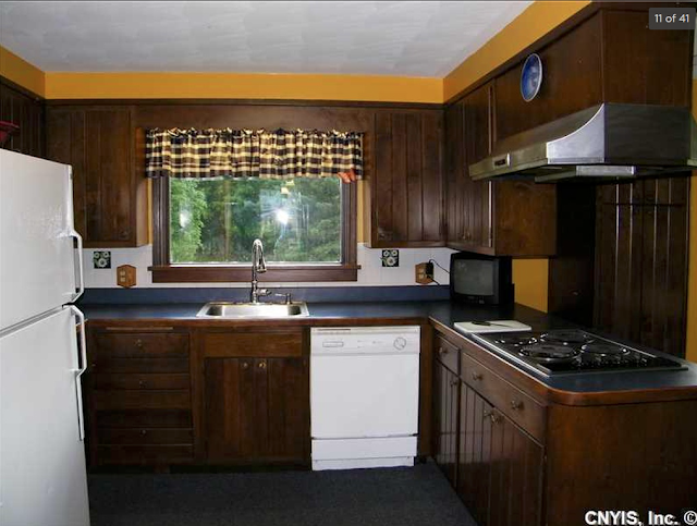 dark wood kitchen with bright yellow walls, Aladdin Charleston, 99 Mexico St Camden NY