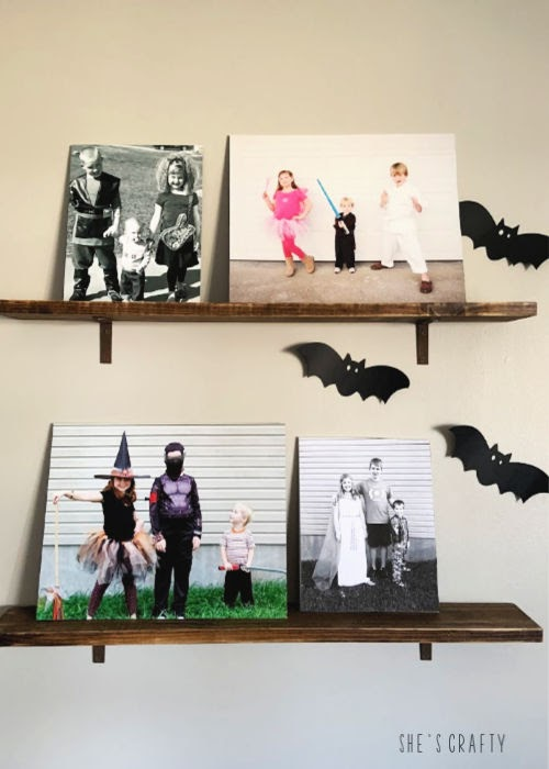 Halloween Home Tour - yearly costume photos displayed as decor  |  She's Crafty
