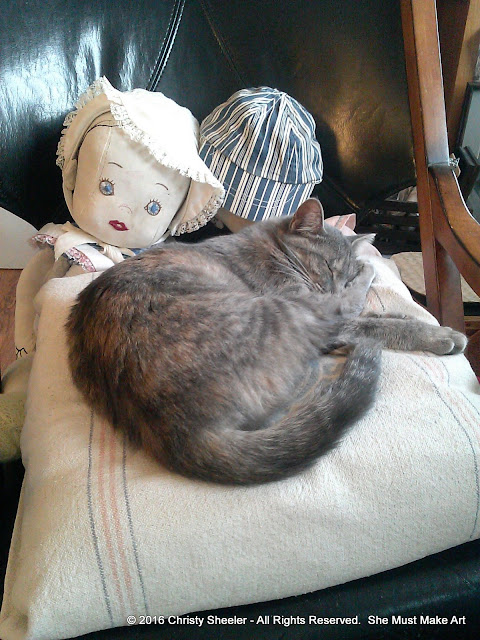Lucy, my cat, sleeps nearby while I work in my art room.