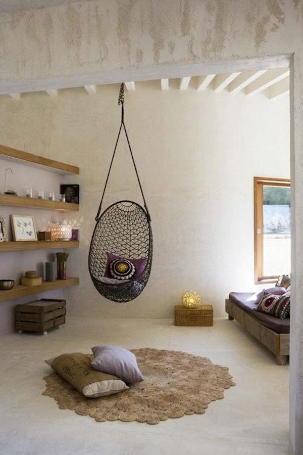 10 formas de veranizar tu casa con guiños tropicales; Salón con hamaca colgante