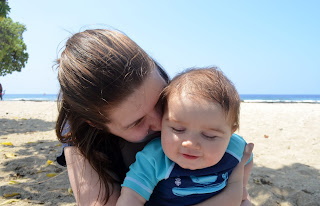 mama with her sweet toddler boy. snuggling on the beach