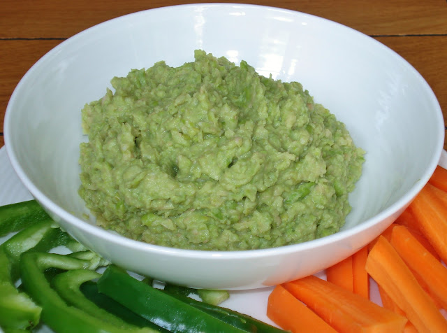 Bowl of Bean and Pea Dip with raw vegetable crudites