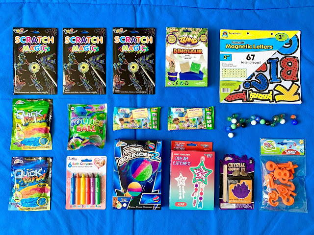 a flat lay of craft and activity products from PoundToy as described in the above paragraphs