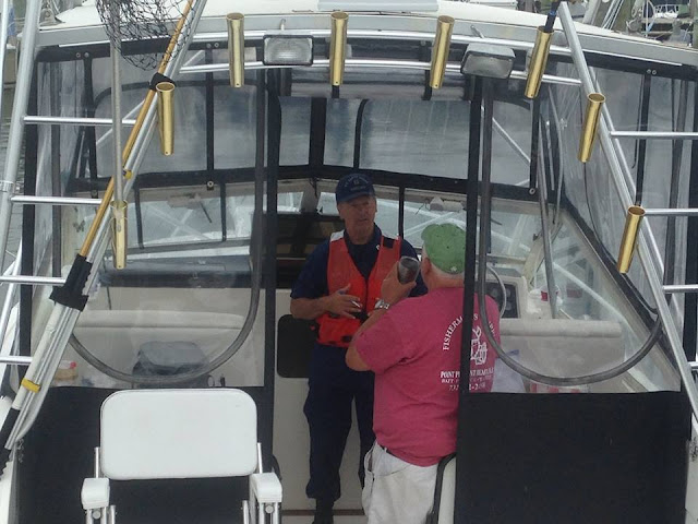 Bill Iwanyk talks to a boater about his vessel.