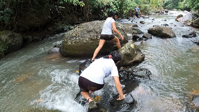 girl hikers river crossing