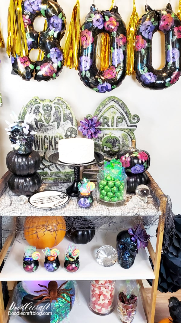 Some iridescent tissue paper is the perfect finishing touch for stuffing these mini cauldrons with treats!