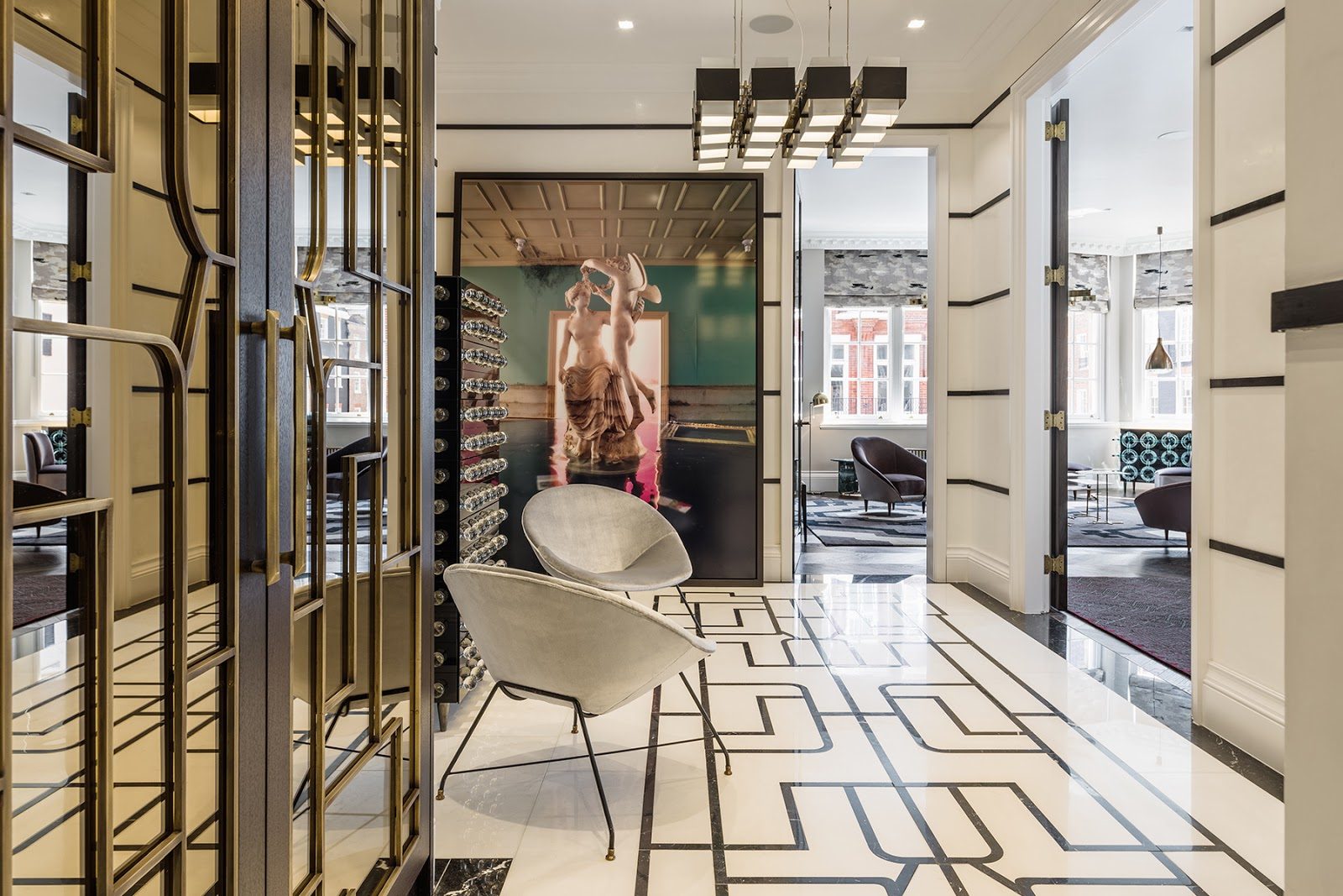 Luxurious eclectic London apartment with pattern geometric rugs, mid century modern furniture and art, ornamented doors