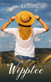 Rear view of young woman in white with straw hat, looking out over country view hat look