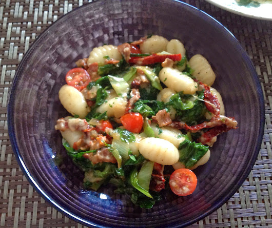 Gnocchi with Bacon, Escarole, and Tomatoes