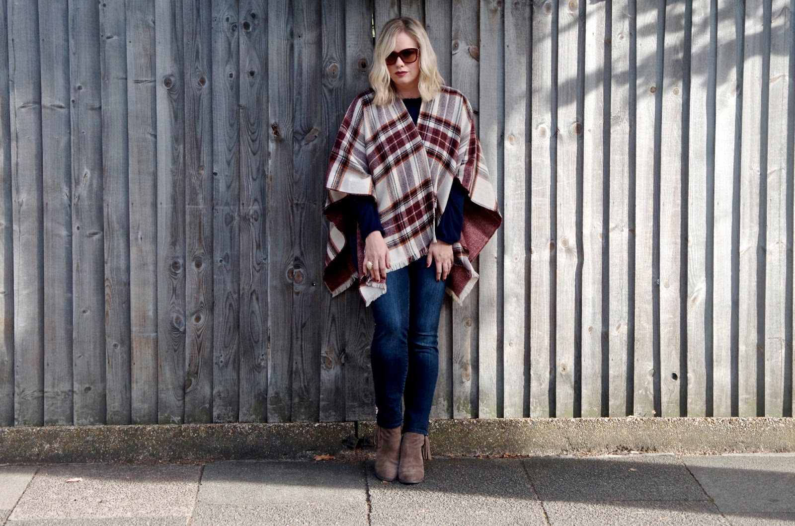 Wool tartan poncho with skinny jeans and fringe booties