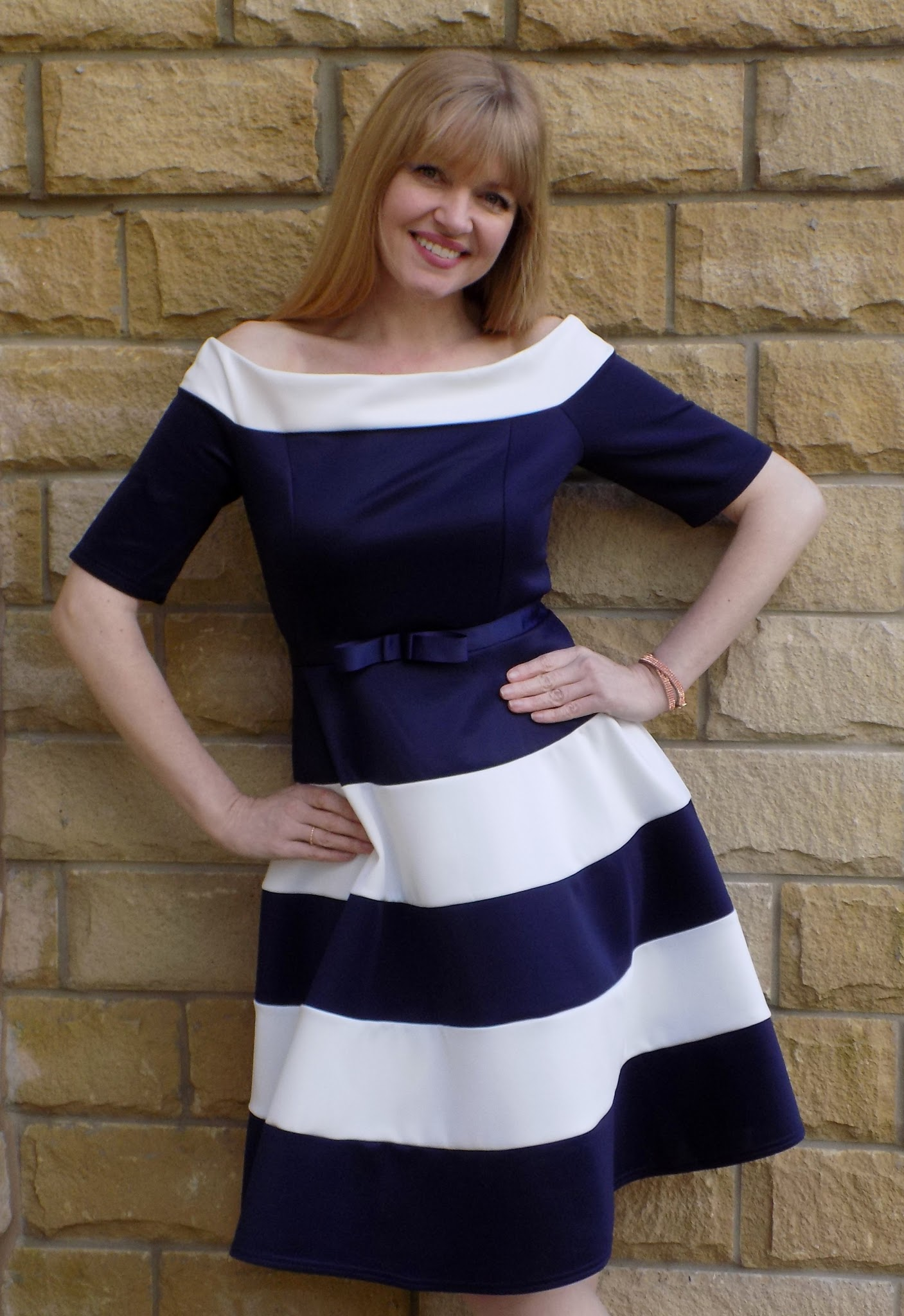 What Lizzy Loves wears Kaleidoscope navy and white prom dress