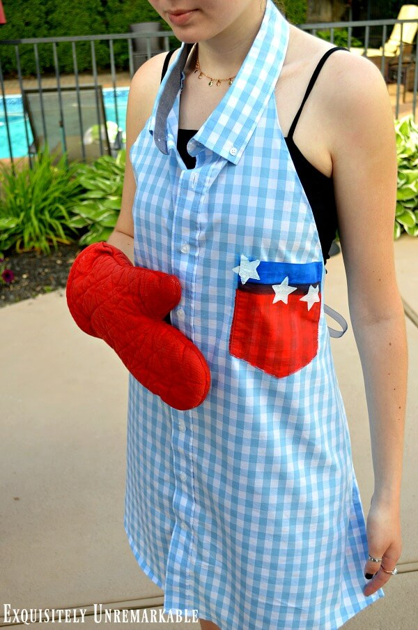 Patriotic Gingham Shirt Apron on model holding an oven mitt