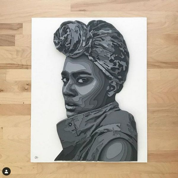 bust of woman looking sideways in layered shades of gray paper