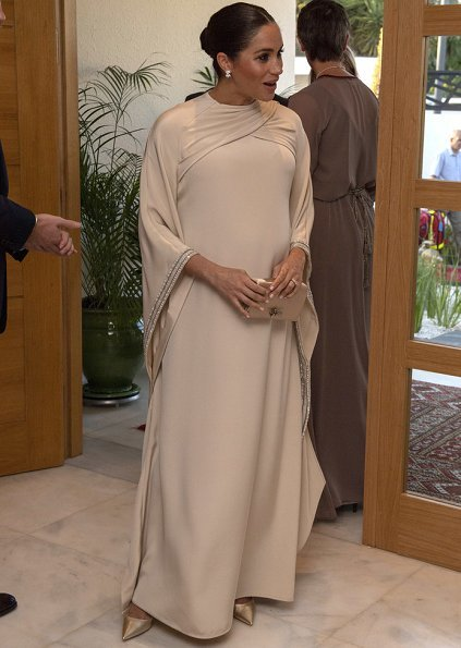 Meghan Markle wore a bespoke dress by Dior featuring draped sleeves and Birks Snowflake Snowstorm diamond earrings