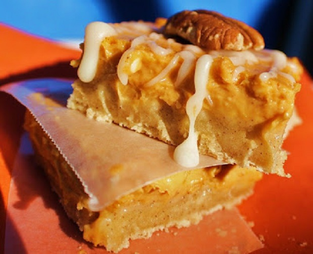 These are pumpkin cheesecake bars made from a cake mix for Halloween parties
