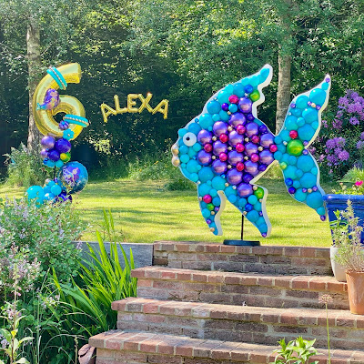 Vibrant coloured balloons have been used to create this beautiful garden decoration for a Childs 6th birthday celebration. Decor made by Sue Bowler