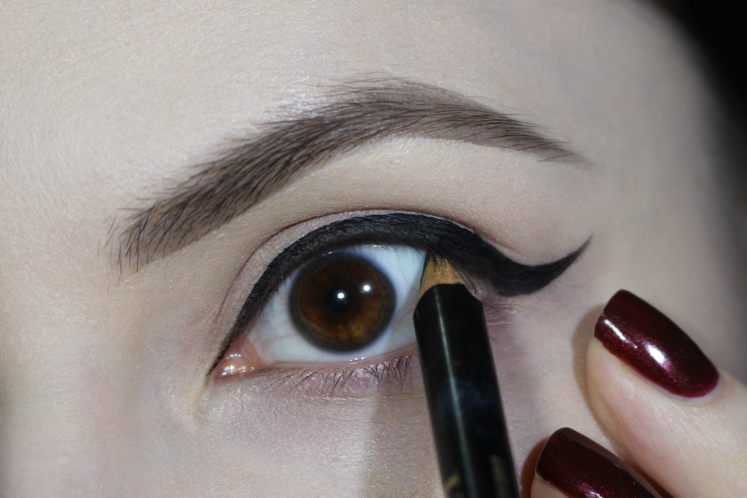 a close-up picture of an eye with a dramatic eyeliner makeup